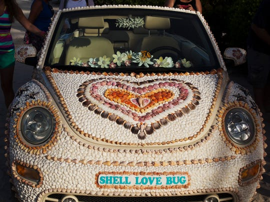 "A ""Good Morning America"" crew, including weather anchor Ginger Zee, spent the morning of June 19, 2016, at the Sundial Beach Resort and Spa celebrating National Sea Shell Day. The Lee County Visitor and Convention Bureau sponsored the event. The Shell Love Bug was unveiled that day. Pam Rambo, along with volunteers, glued the shells to the car. Rambo claims the county promised to give her the car. Her company has sued Lee County in U.S. District Court. She also claims that by continuing to display the vehicle in public, the county has violated her copyright on the design. The News-Press tried to get access to the car to get photos of what it looks like in 2018 but was denied. In an email written by Lee County Spokeswoman Betsy Clayton: ""Per the County Attorney's Office, we are not able to accommodate your request. The car is covered and is not available for public or media inspection at this time since the design of the shells attached to the car is involved in a copyright lawsuit."""