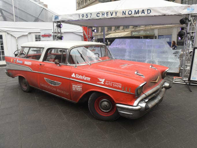 A 1957 Chevrolet Nomad is parked at Campus Martius