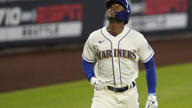 Seattle Mariners' Kyle Lewis looks up as he rounds the bases after hitting a solo home run against the Texas Rangers during the first inning of a baseball game, Sunday, Aug. 23, 2020, in Seattle.
