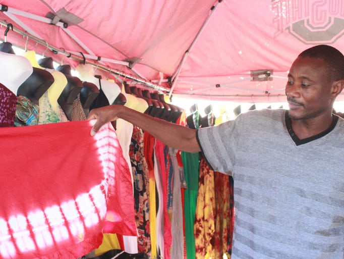 Bidy Camara displays his wares Friday at the African Street Festival held at the Jackson Fairgrounds Park.