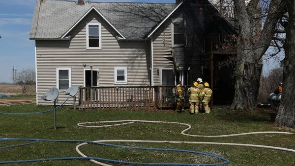 A fire severely damaged a house in the town of Richfield, at 8188 County Road EE, Tuesday, April 28, 2015.
