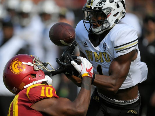 Western Michigan defensive back Sam Beal, right, intercepts a pass intended for Southern California wide receiver Jalen Greene during the second half of an NCAA college football game, Saturday, Sept. 2, 2017, in Los Angeles. (AP Photo/Mark J. Terrill)