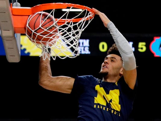 Michigan forward Isaiah Livers dunks the ball during a practice session for the Final Four NCAA college basketball tournament, Friday, March 30, 2018, in San Antonio. (AP Photo/David J. Phillip)