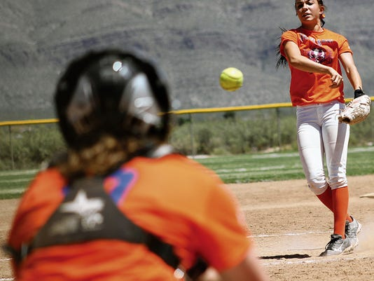 Macie Perrin throws a pitch towards Breanna Jacob on Saturday at the Travis C. Hooser Ballfield Complex.