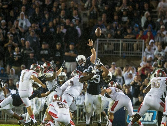 Penn State players try to block a Rutgers field-goal attempt during the second half of Saturday's game at Beaver Stadium.