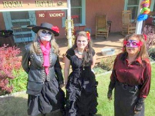 Three ghostly gals were at the celebration.