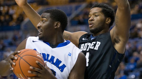 Butler's Tyler Wideman (right) defends Indiana State's TJ Bell during a game Dec. 3, 2014 at the Hulman Center in Terre Haute. Butler won 77-54.