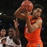 Brissett's double-double lifts Syracuse past UConn, 72-63