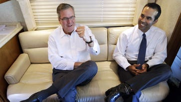 Former Florida governor Jeb Bush and his son, new Texas land commissioner George P. Bush, in October in Abilene.