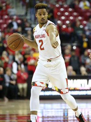 Maryland Terrapins guard Melo Trimble (2) controls the ball against the Rider Broncs at Xfinity Center.
