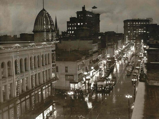Fowler's decorated with holiday lights, around 1930,