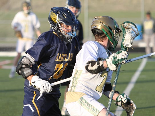 Howell's Ethan Porath (left) defends Howell's Eric