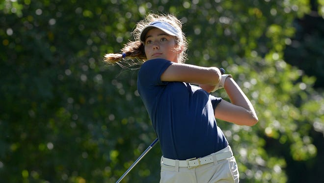 Pittsford's Lena Kaufman watches her tee shot on the fourth hole.