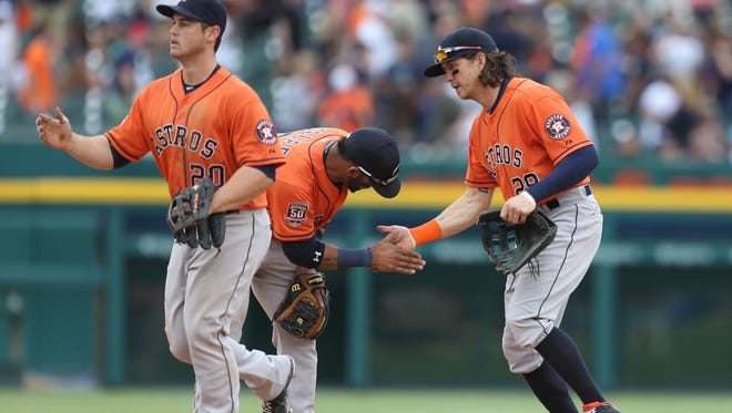 The Houston Astros celebrate their 10-8 win over the Tigers on Sunday, May 24, 2015 at Comerica Park in Detroit.