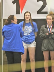 Scott senior Lindsey Fox with her state championship medal during the KHSAA state swimming and diving championships Feb. 24, 2018 at the University of Louisville.