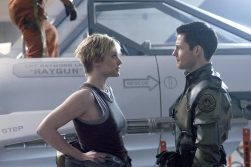 Katee Sackhoff as Starbuck and Jamie Bamber as Apollo in