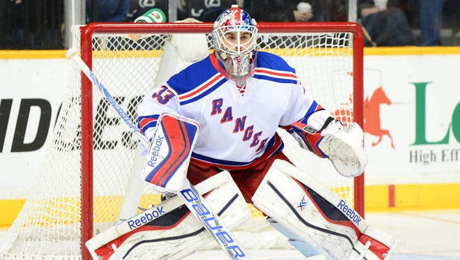 New York Rangers goalie Cam Talbot (33) stands in the goal against the Nashville Predators during the second period at Bridgestone Arena. The Rangers beat the Predators 2-0.