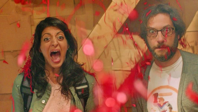 """Annie (Meera Rohit Kumbhani) and Gordon (Adam Busch) are alarmed by what they see in """"Dave Made a Maze."""""""