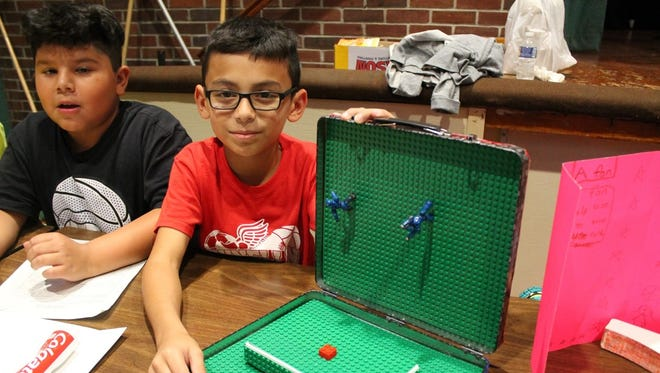 Third-graders Jeremias Perez-Vargas and Noe Guzman explain their inventions at Faber School in Dunellen.