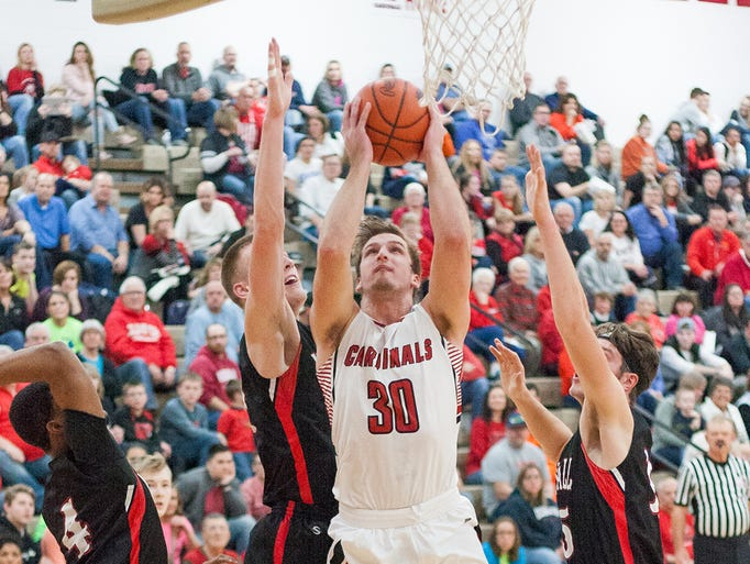 Coldwater's Brady Beckhusen (30) goes up for a layup