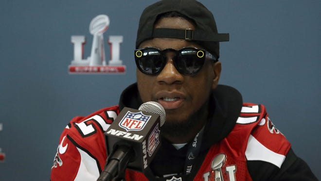Atlanta Falcons receiver Mohamed Sanu (12) wears sunglasses as he answers questions during a press conference at Westin Houston Memorial City Hotel on Feb. 2.