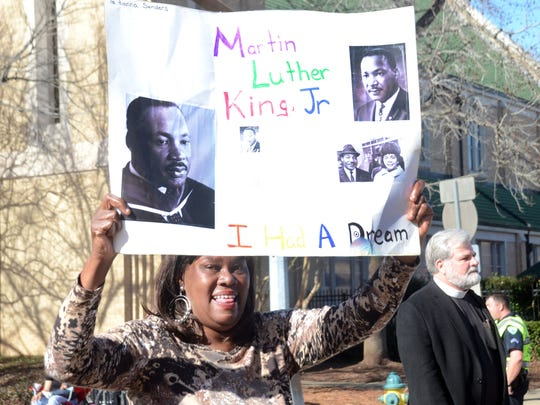 ANI MLK Day Parade Theresa Sanders marches in the Dr. Martin Luther King Jr. Day Parade was held Monday, Jan. 19, 2015 in downtown Alexandria.-Melinda Martinez/mmartinez@thetowntalk.com The Town Talk Gannett