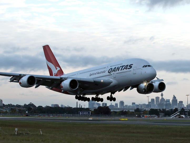 A Qantas A380 lands at Sydney International Airport