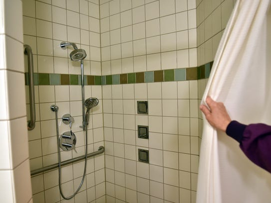 Spa-style showers with heated tile floors and side