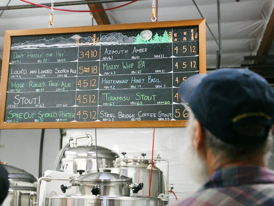 Chris Perry looks at the beer options at Salem Ale