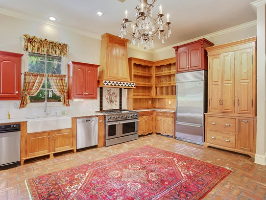 The kitchen space includes beautiful appliances and