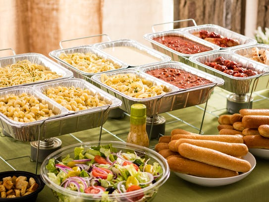A pasta station and other lunch time dishes served