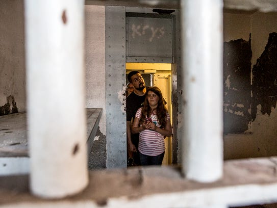 Tourists tour the Licking County Historic Jail before