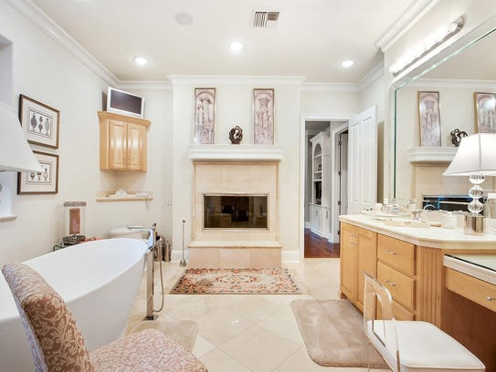 The master suite includes his and her bathrooms.