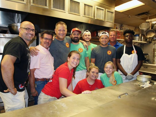 Volunteers from Big Apple Pizza and the Van Duzer Foundation