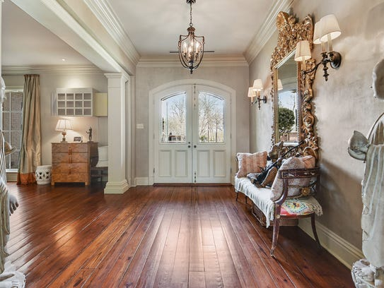 The formal entrance features gorgeous wood floors in