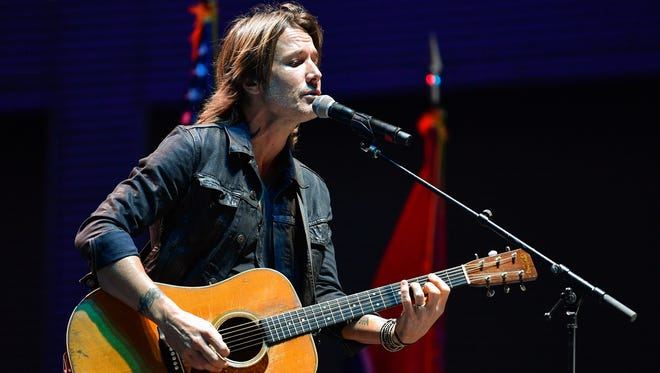Keith Urban performs at Nashville's vigil for Las Vegas shooting victims Monday, Oct. 2, 2017, at Ascend Amphitheater in Nashville, Tenn.