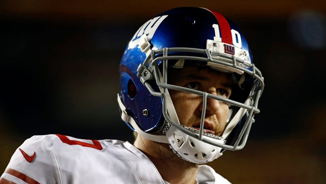 Eli Manning warms up before the Giants' Thanksgiving night game against the Washington Redskins. (AP Photo/Patrick Semansky)