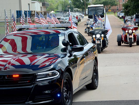 Local law enforcement officers and Patriot Guard motorcyclists