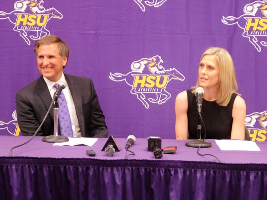Hardin-Simmons athletic Director John Neese, left, introduces Kendra Hassell as the new Hardin-Simmons women's basketball coach during a press conference at the Moody Center on Monday, March 26, 2018.