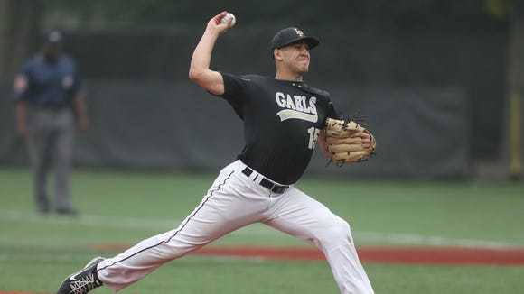 Iona Prep pitcher Sam Bello delivers a pitch during