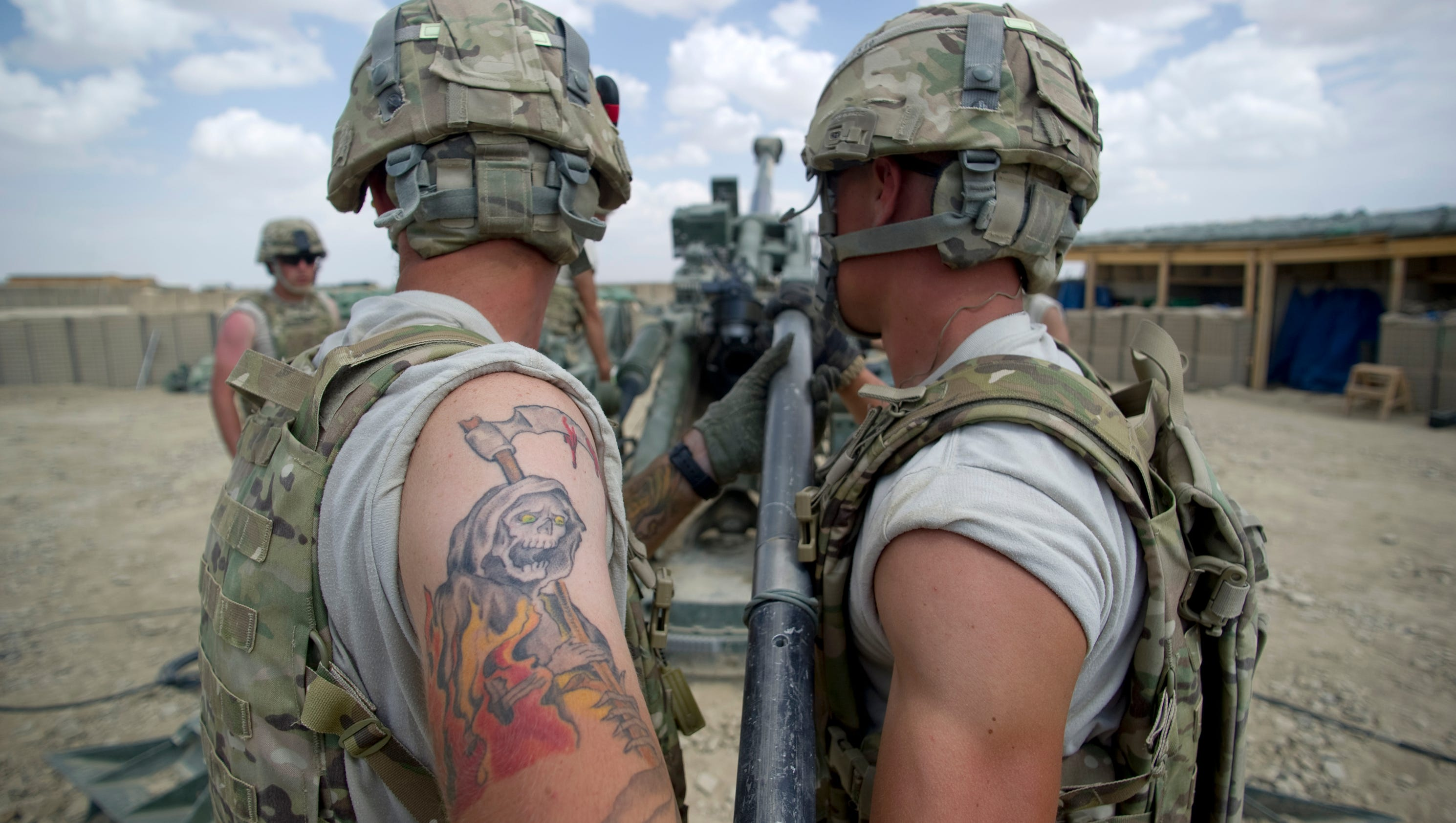 Army eases rules on soldiers 39 ink for Tattoo requirements for national guard