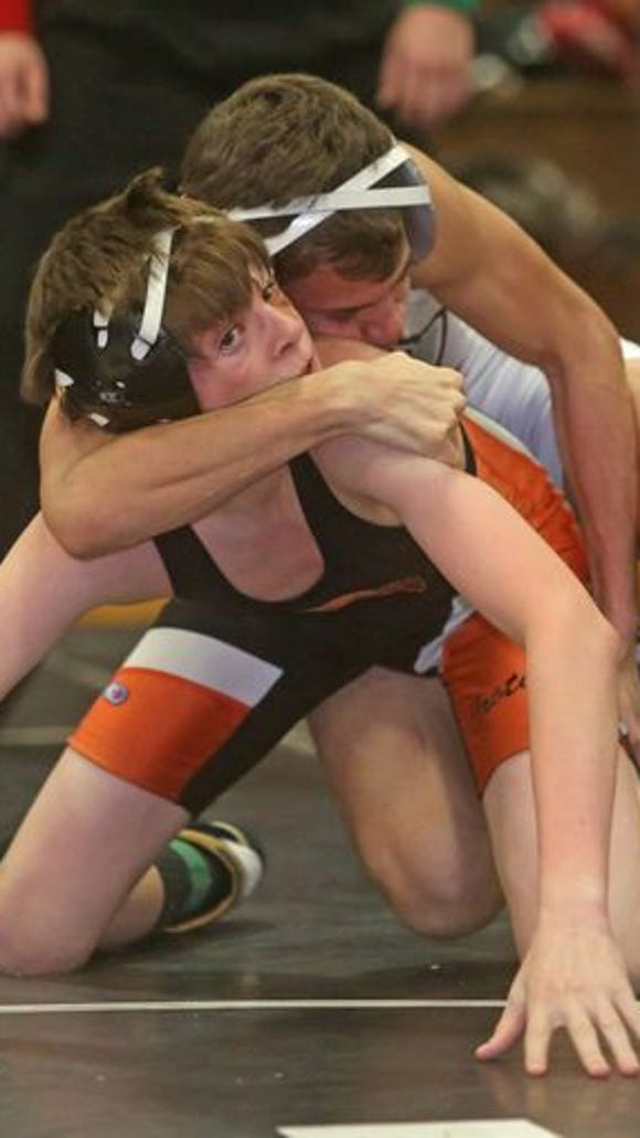 Jay Martins of Harrison defeated Thomas Barsuch of Croton 8-4 in the 106 pound final at the Westchester County Classic Wrestling Championship at Yonkers High School Jan. 25, 2015.