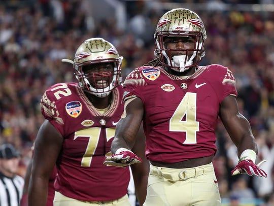 Former Seminoles offensive guard Kareem Are (left)