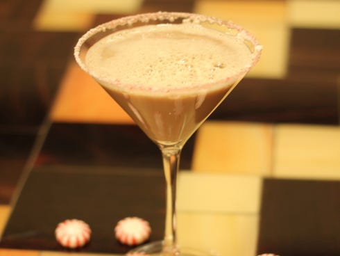 The brisk and minty peppermint mocha martini is made with Kahlua, vanilla vodka, peppermint schnapps and Godiva chocolate liqueur.