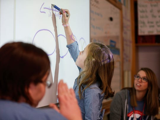 Paityn Thomas, a student in Katie Baker's class, shows