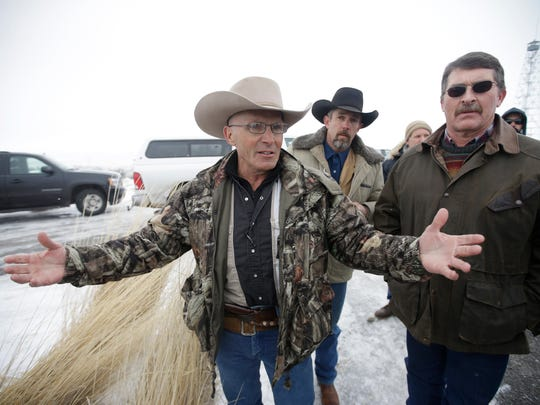 """In this Jan. 9, 2016, photo, Robert """"LaVoy"""" Finicum, left, a rancher from Arizona, talks to reporters at the Malheur National Wildlife Refuge near Burns, Ore. The family of Finicum, an Arizona rancher fatally shot by Oregon State Police during the armed occupation of a national wildlife refuge, alleged in a federal lawsuit Friday, Jan. 26, 2018, that he was """"deliberately executed by a preplanned government ambush."""""""