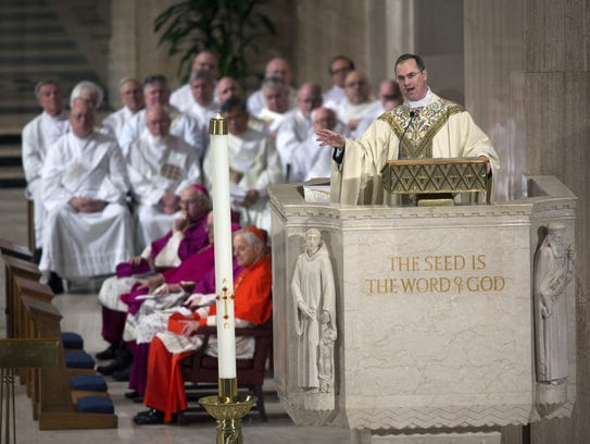 Father Paul Scalia presides over the funeral Mass for