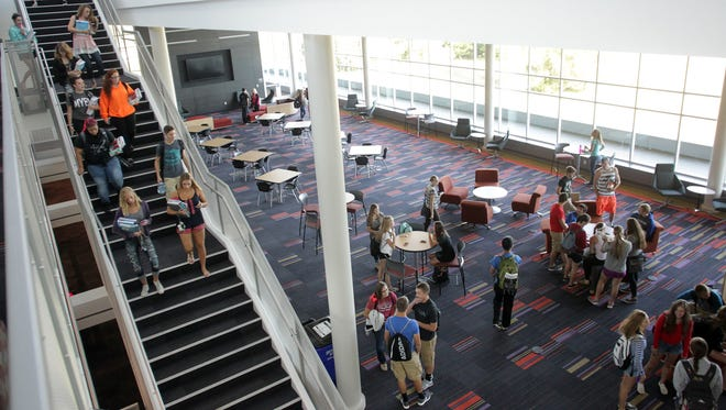 Students file out of their classrooms at the Kirkwood Regional Center at the University of Iowa in Coralville  at the University of Iowa in Coralville on Monday, Aug. 24, 2015.