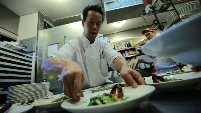 Chef Brion Wong, shown working in the kitchen at Antietam restaurant in July, is the new chef de cuisine of the Peterboro restaurant, scheduled to open late this year or early in 2016.