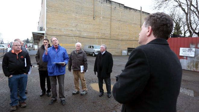 Councilor Tom Andersen (center) asks Jake Davis with DLR Group (far right) a question concerning a potential site for the new police facility in Salem on Tuesday, Jan. 5, 2016. Councilors and other city employees toured four potential sites for the facility, including this lot on Liberty and Broadway streets.